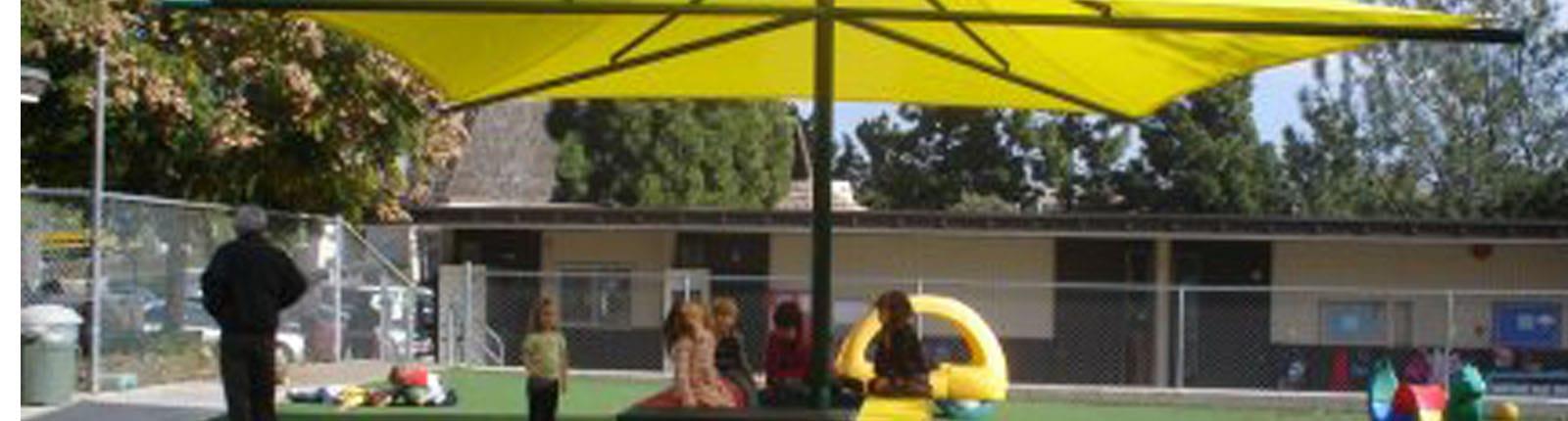 Preschool Kids Under Umbrella   Sterling West
